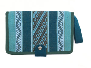 The Mama Qucha Cuzco Clutch | nappy clutch / diaper clutch in dark waves design showing close up of front snap closure