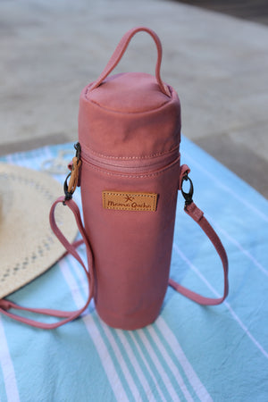 The Mama Qucha insulated bottle carrier / baby bottle holder in pink cotton show closed and on towel