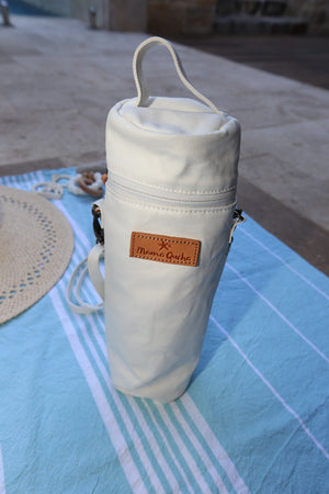 The Mama Qucha insulated bottle carrier / baby bottle holder in waxed white cotton show on a towel