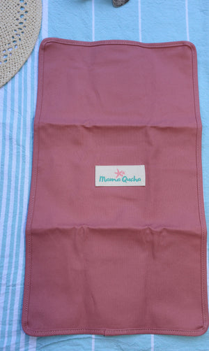 Back of the Mama Qucha baby change mat in pink showing logo