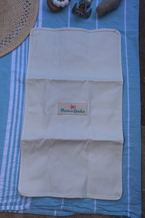 Back of the Mama Qucha baby change mat in white waxed cotton