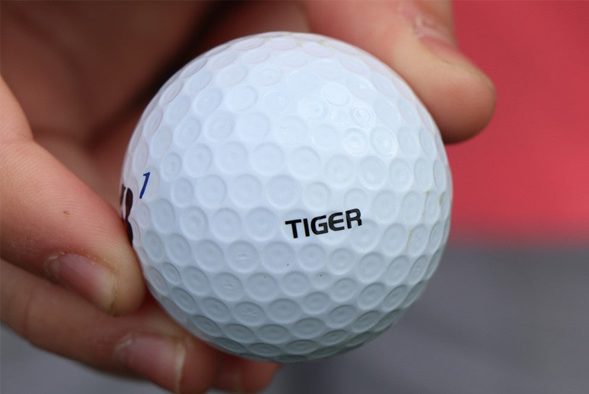 "Bridgestone also sells TW Edition Tour B XS golf balls printed with ""Tiger"" on the side, just like Tiger Woods has on his golf balls."