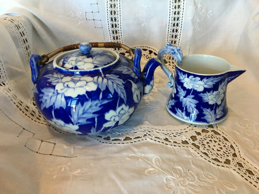 Blue & White Design Tea Pot has a Bamboo Handle & Creamer, has a Dragon Handle