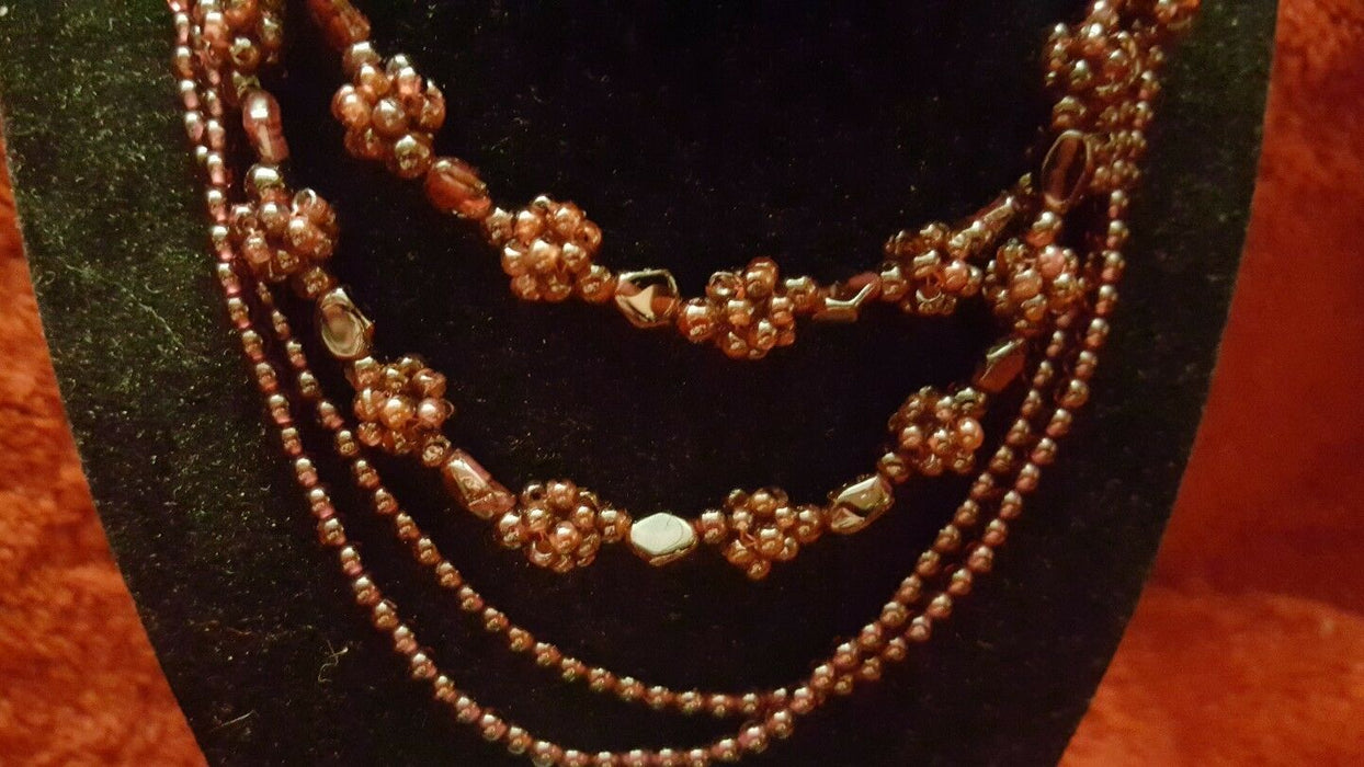 Vintage Egyptian red glass bead necklaces from the Nasha Bazaar in El Maady