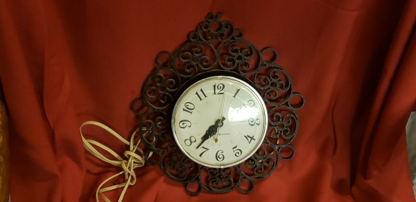 Vintage General Electric Black Scroll Wall Clock Hard Plastic GE Model 2151