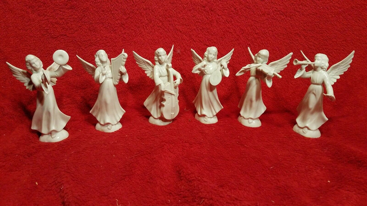 Set of 6 Vintage Dresden White China Musical Angel Figurines.