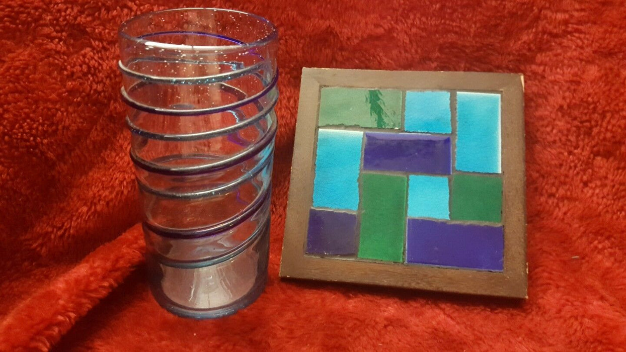 Elegant drinking Glass or a Beautiful hand blown Blue Green Vase with trivet