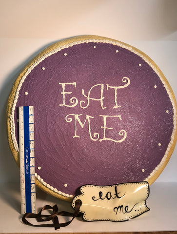 "Jumbo foam cookie prop with ""Eat Me"" written in the middle of it. Great for Alice in Wonderland-themed event."
