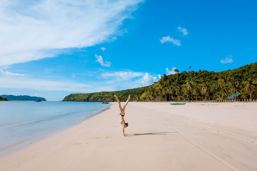 Best Exercises For Weight Loss handstand beach
