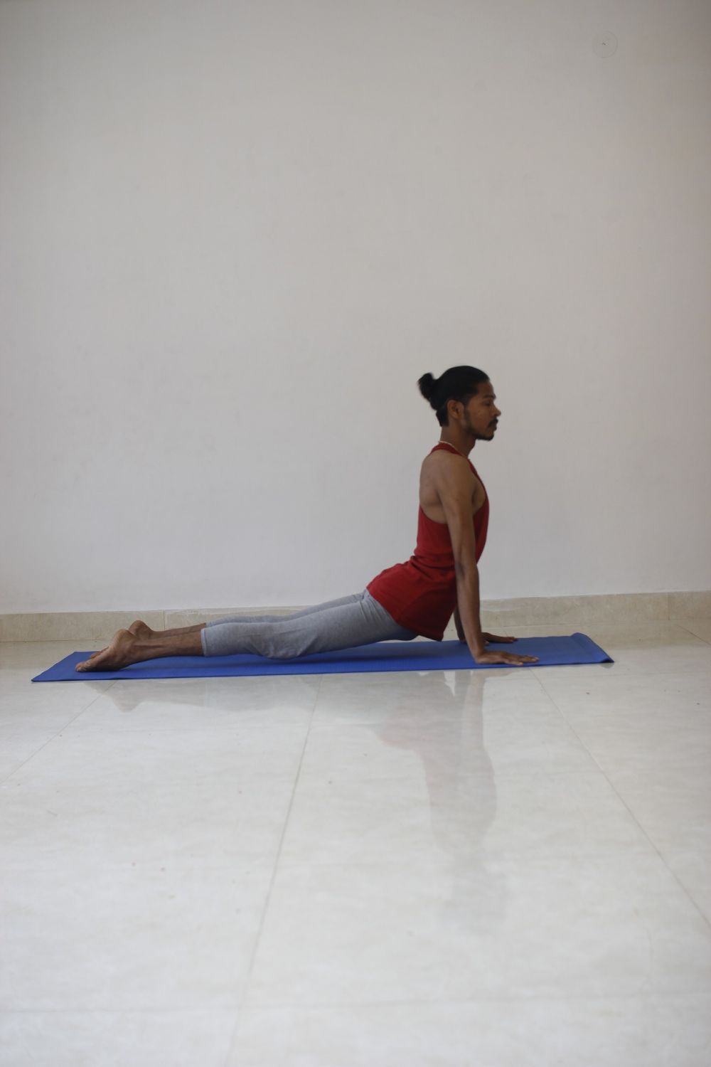 How To Do The Yoga Cobra Pose Or Bhujangasana