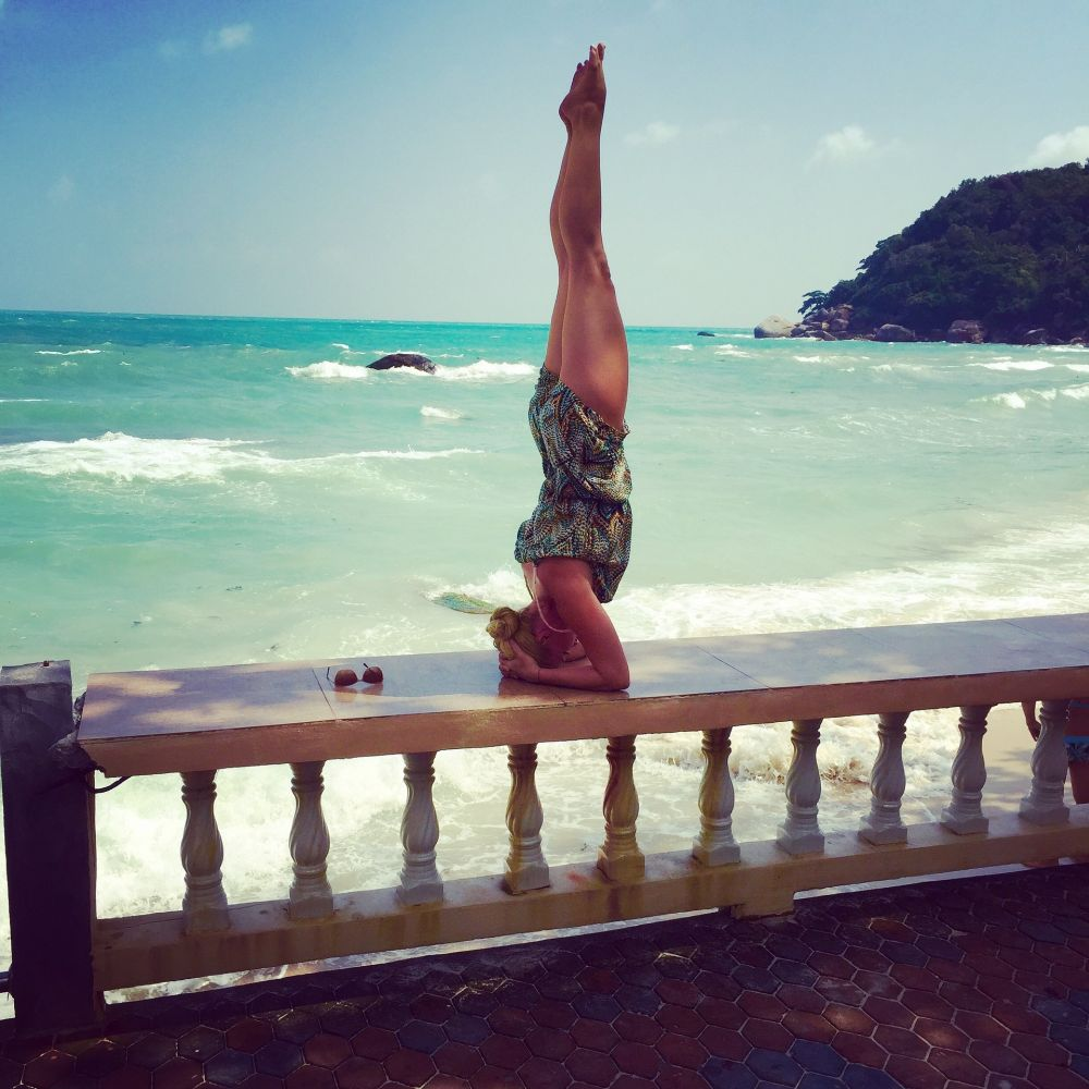 yoga challenge poses headstand beach