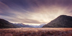 Sunset behind the mountains at Arthurs Pass, New Zealand