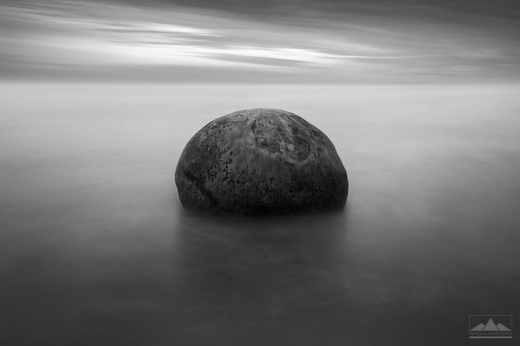 Otago's Moeraki boulder in smooth long exposure black & white photo