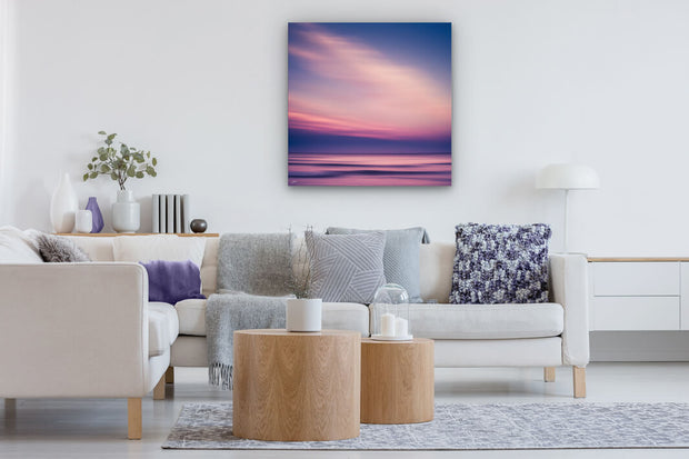 Canvas abstract art on a neutral lounge wall of a Canterbury beach at sunset.