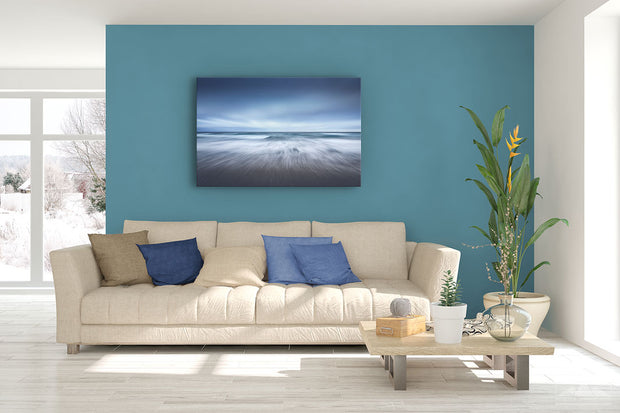Canvas photo print of an abstract ocean scene on display on living room wall