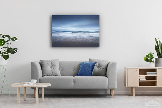 Canvas photo print of an abstract ocean scene on display on lounge room wall