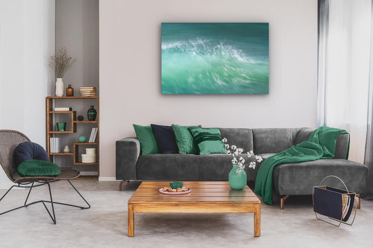 Abstract canvas print of aqua coloured New Zealand wave crest on lounge wall.