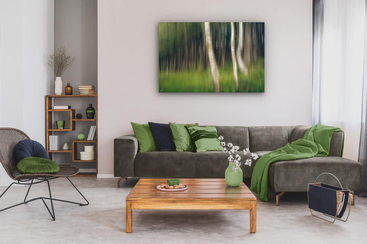 Lounge wall with a large canvas print of an abstract forest