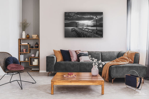 Black and white wall photo print of sunset in Akaroa harbour on display on living room wall