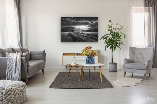 Canvas black and white wall print of sunset in Akaroa harbour on display on lounge wall