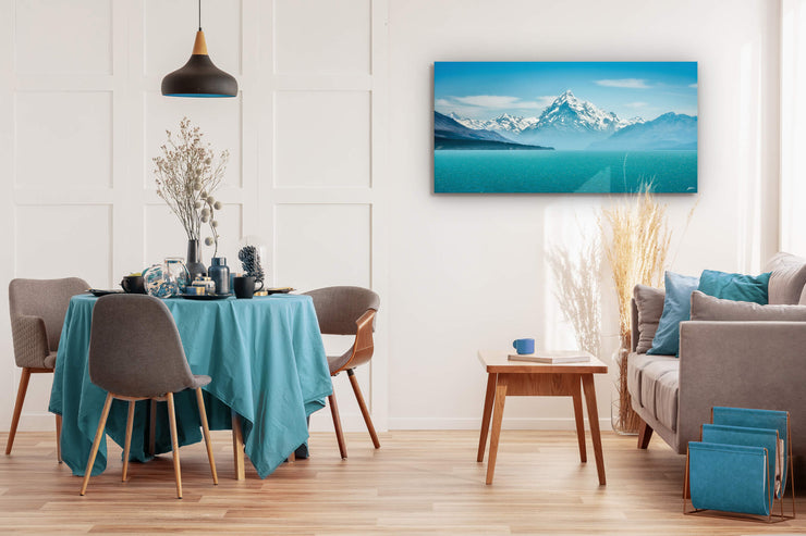 Aoraki Mount Cook canvas print on the wall of a modern dining room.