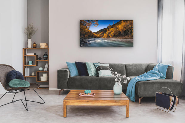 Arrowtown river photo on canvas, displayed on an interior house wall.