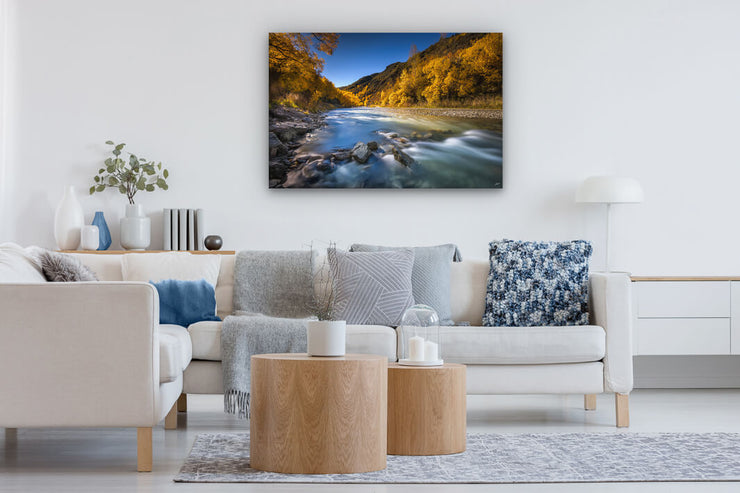 Modern lounge with a canvas print on the wall of Arrowtown at autumn.
