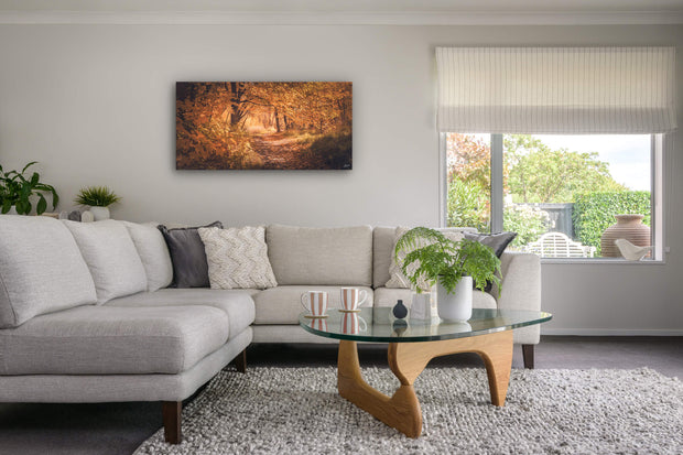 Lounge room with canvas print on the wall of Arrowtown in autumn.