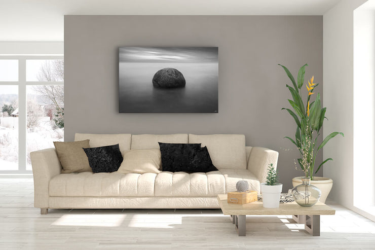 Canvas wall art of a Moeraki boulder up on a lounge wall