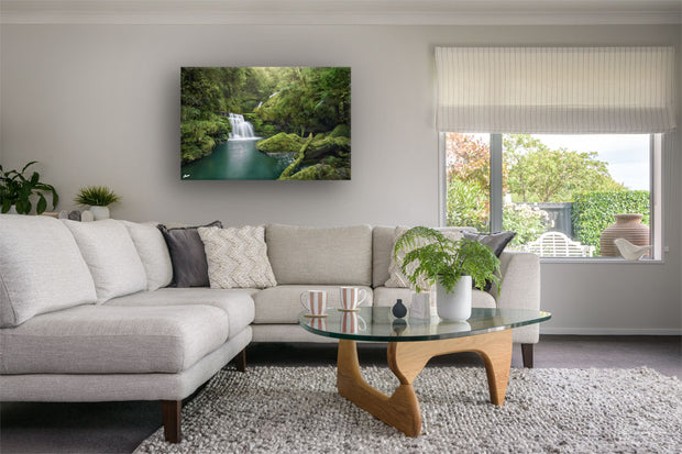 Modern neutral decor lounge with canvas print on the wall of McLean Falls