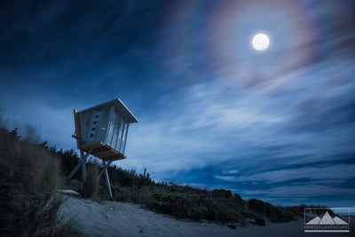 Woodend Beach photograph at night, lit by the moon. Canvas and photo print.