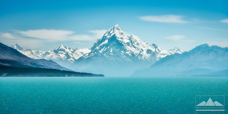 Clear image of snow capped Aoraki Mt Cook looking across the turquoise blue waters of Lake Pukaki.