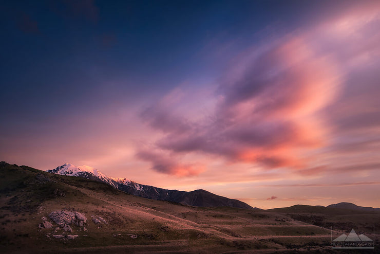 New Zealand landscape photo of sunset clouds in a pink colour