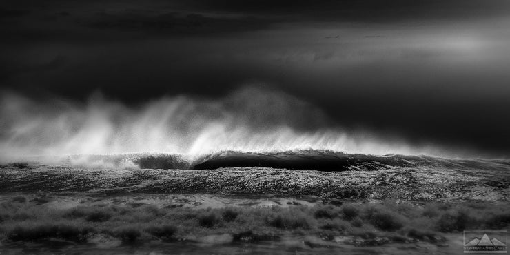 Fine art abstract black and white photo of crashing waves at the beach