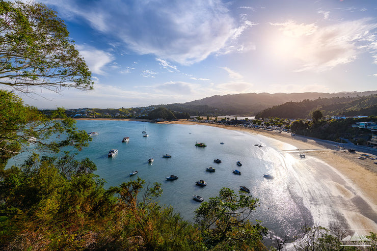 Landscape view looking down over Kaiteriteri beach and boats in summer