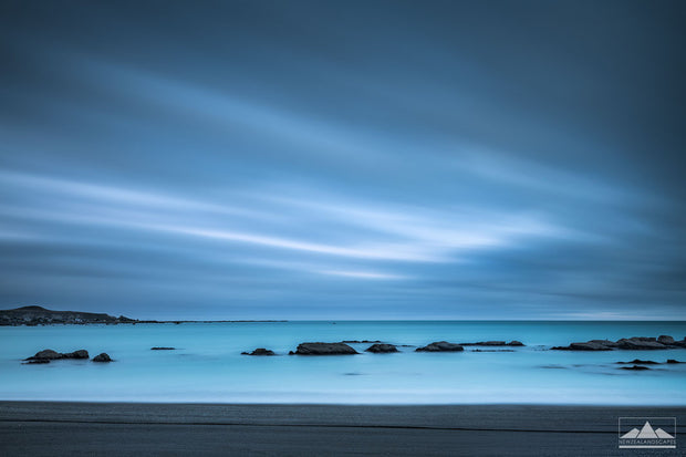 Long exposure fine art photograph of rocks in the sea at Kaikoura