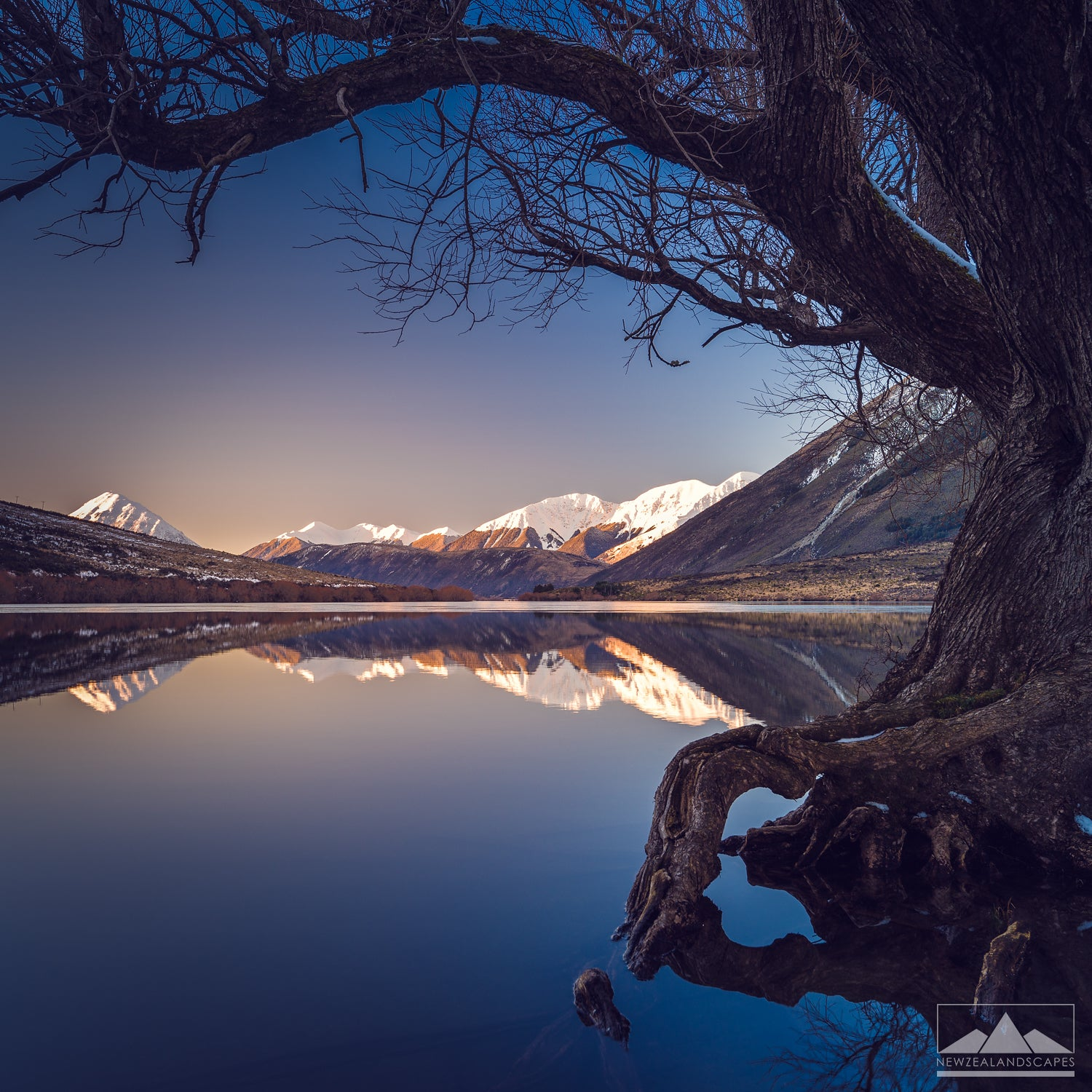 stunning reflection at lake pearson with snow capped mountains