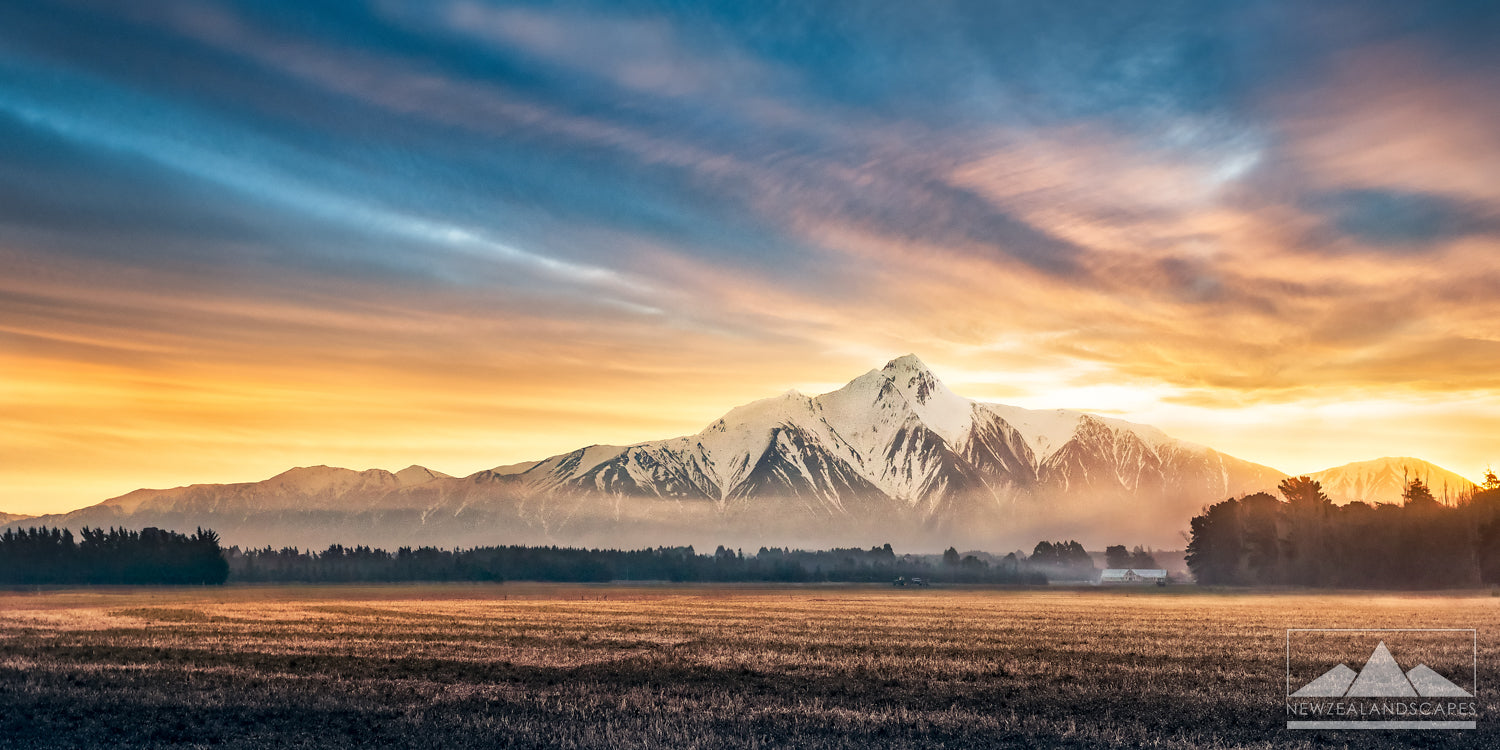 Gorgeous sunset in this panoramic view of the Southern Alps mountain range in New Zealand