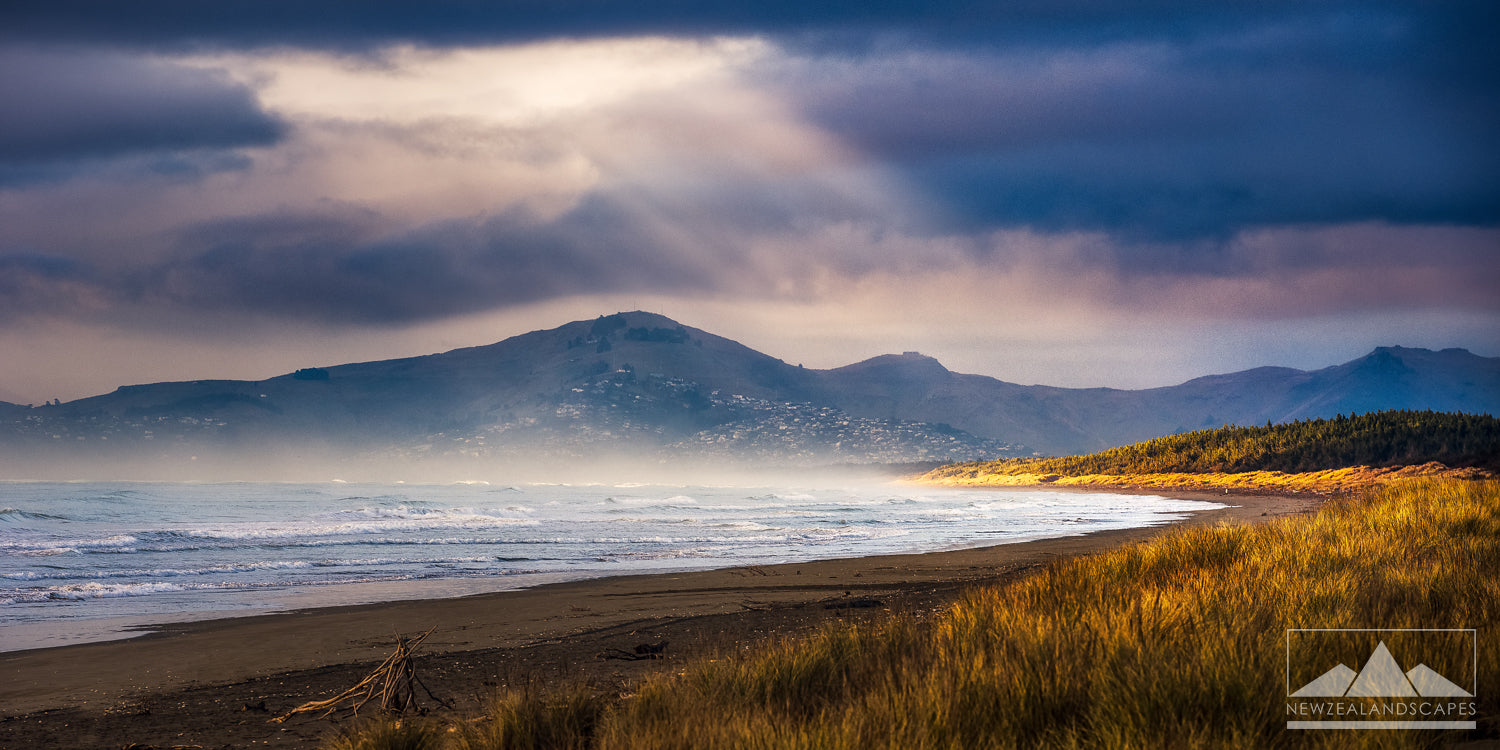 Beautiful sunbeams through cloud over Woodend Beach photograph