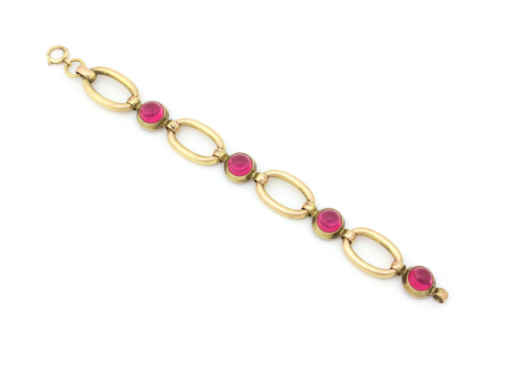 Gold link bracelet with pink cabochons