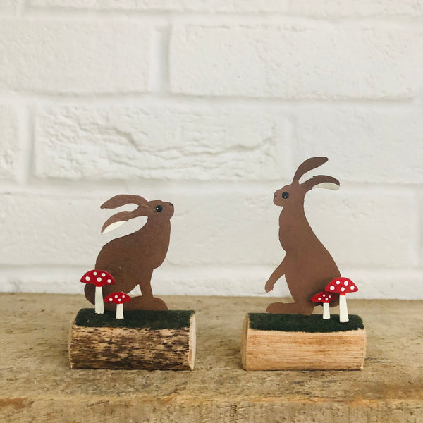 Pair of Hares on logs decoration