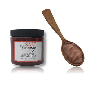 Himalayan salt lavender and sage scrub 16oz and wooden spoon filled with pink scrub salt breeze