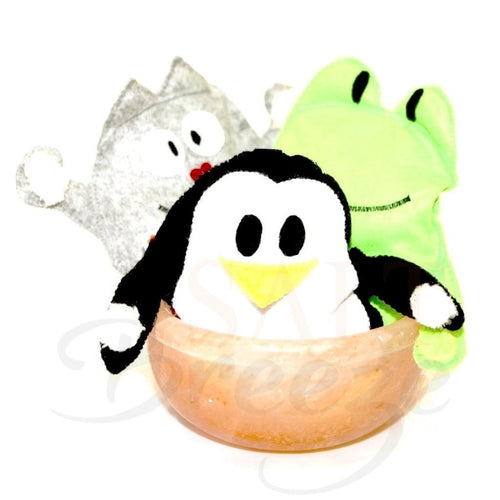 Himalayan Salt Pillow Microwavable Toys Penguin Cat Frog sitting in a Himalayan salt bowl