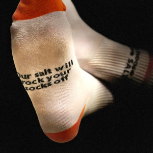 orange and white cotton socks with slogan salt breeze branded