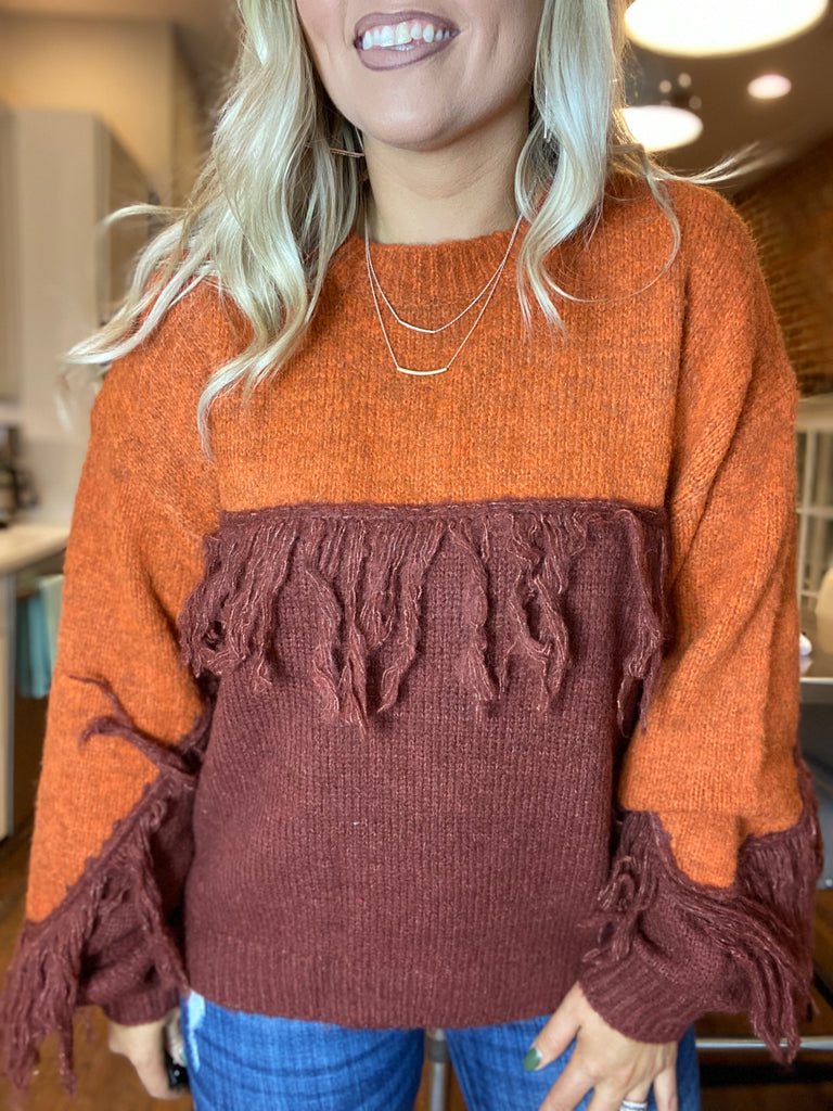Lay By The Fire Fringe Sweater In Rust