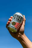 Freestar Premium  0.0% 330ml Good Stuff Drinks Alcohol Free Non Alcoholic Craft Beer Can Gold Award Hand Holding