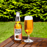 Freestar Premium  0.0% 330ml Good Stuff Drinks Alcohol Free Non Alcoholic Craft Beer Gold Award Glass Poured Outside