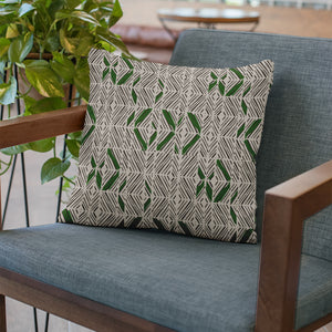 Forest/Stone/Ivory hawaiian inspired 'akahi lumbar pillowcase on chair