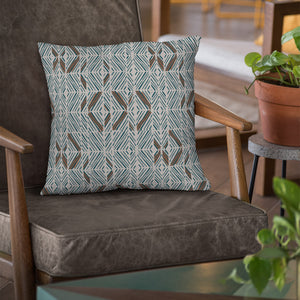 Aqua/Cocoa/Ivory hawaiian inspired 'akahi lumbar pillowcase on chair