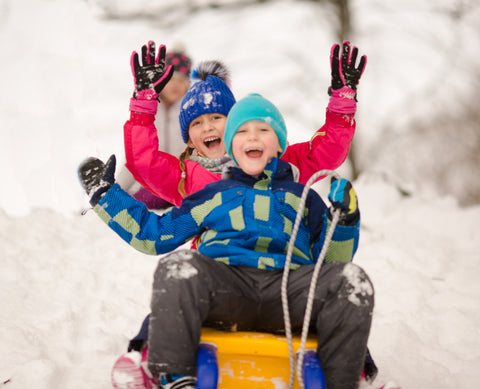 Kids sledding in winter